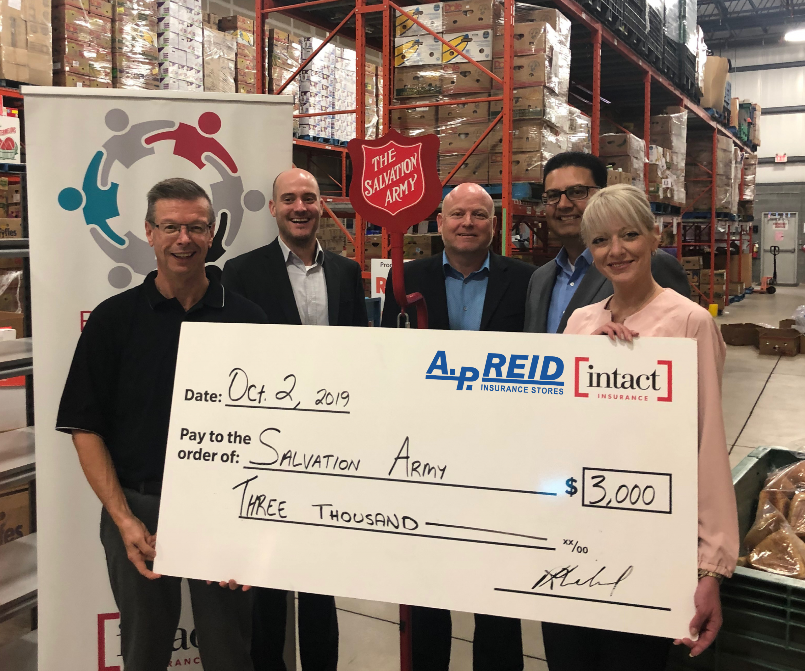 A.P. Reid & Intact Present Donation to Burlington Community & Family Services